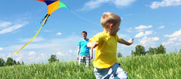 Boy running with a kite
