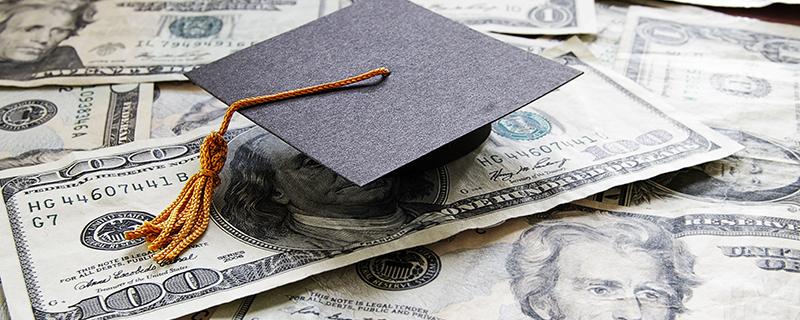 Graduation cap and $100 bills
