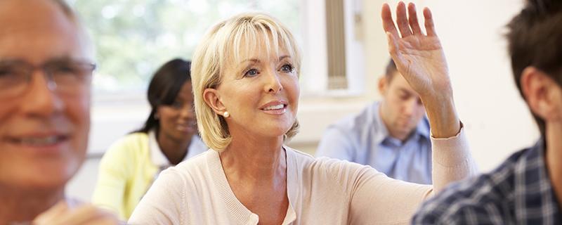 Women raising her hand in a class