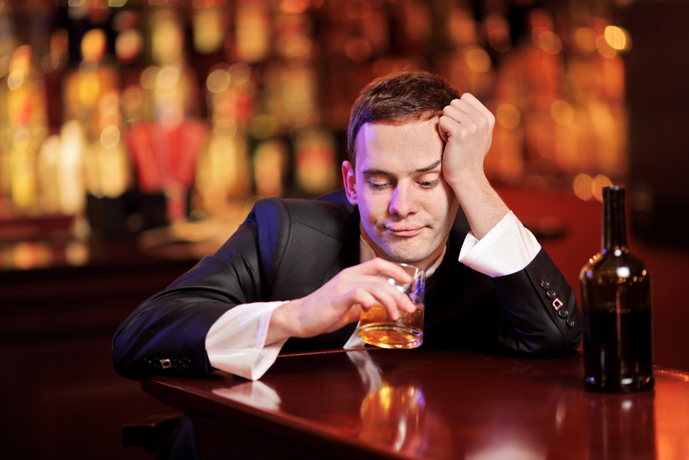 Man in bar (Shutterstock photo)