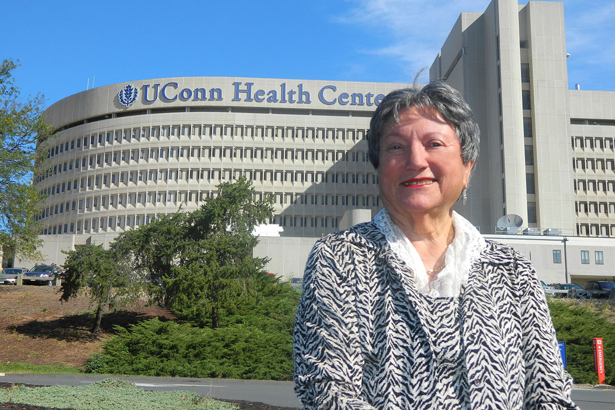 Irene Engel standing in front of UConn Health
