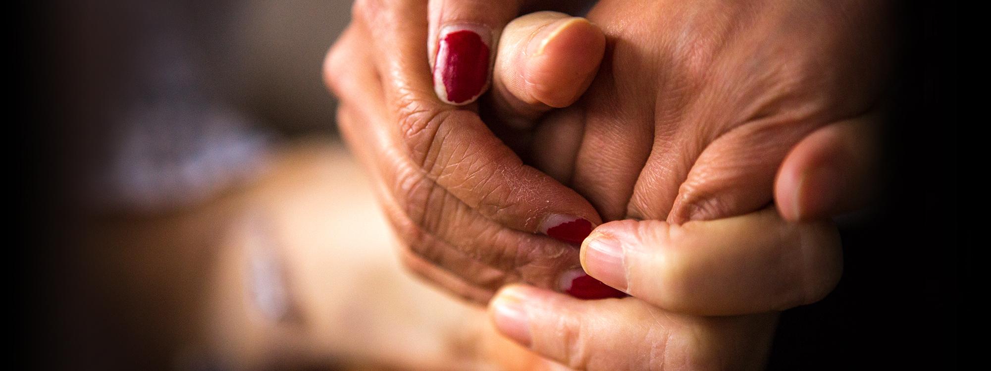 held hands in comforting gesture