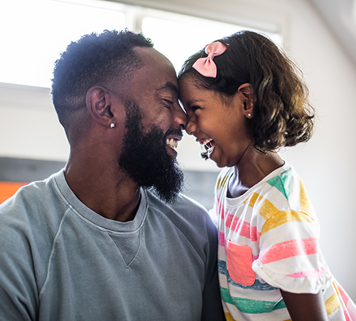 Father and daughter touching faces
