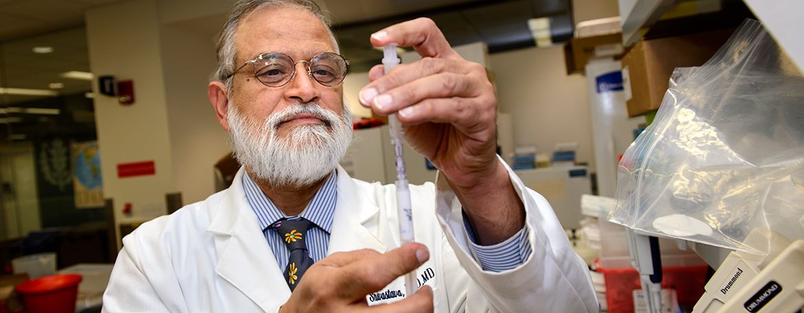 Pramod K. Srivastava, Ph.D., M.D., in his research laboratory