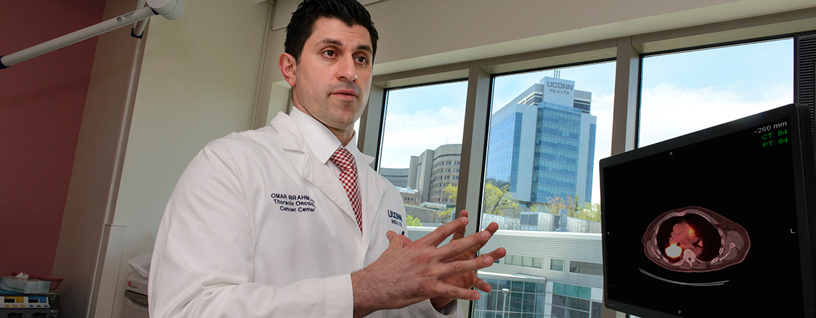 Omar Ibrahim, M.D., discussing test results with a patient