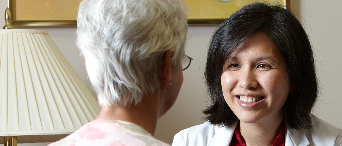 Dr. Meng and Dr. Ferris speaking with a patient.