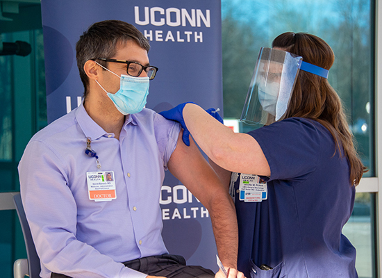 Dr. David Banach receiving the COVID-19 vaccination