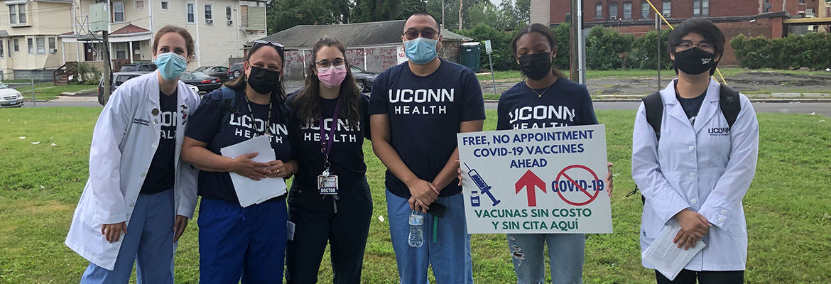 UConn School of Medicine students and staff standing together in Hartford
