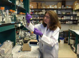Dr. Germain Lee Working in Her Lab