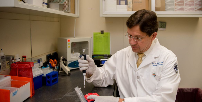 Juan C. Salazar, M.D., M.P.H., in his lab