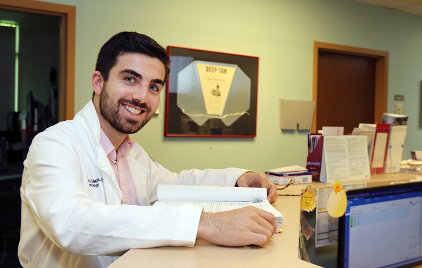 A Dermatology resident smiling at the camera