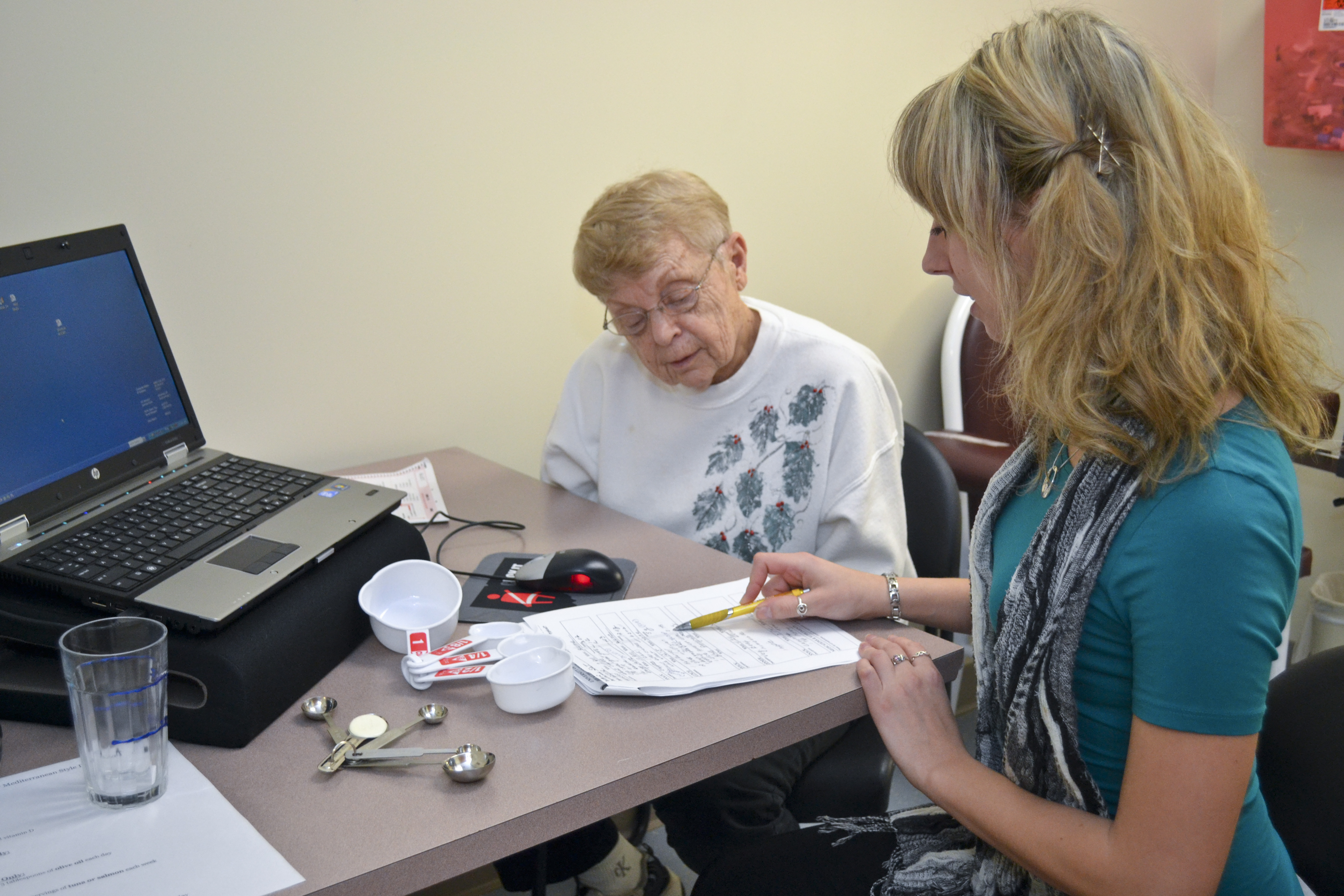 Dietitian Anna Garrett provides a nutrition consultation to a study volunteer in the Center on Aging
