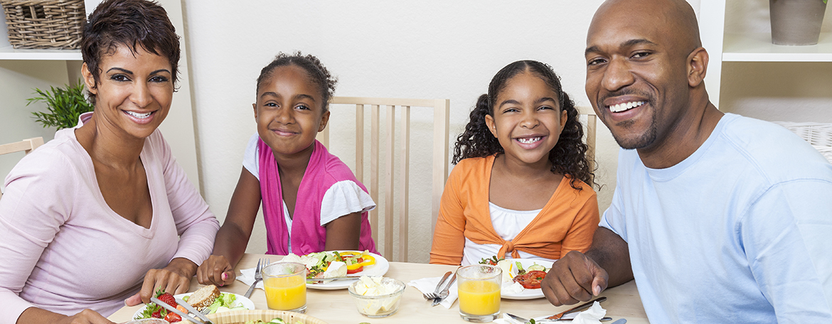 African American family eating lunch