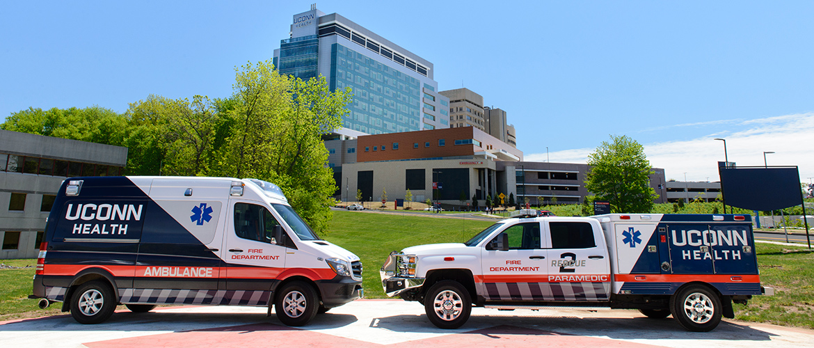 Ambulance and EMS truck on the UConn Health helipad in front of the new hospital tower and emergency room