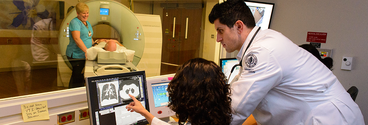 Dr. Omar Ibrahim looking over a low dose CT scan