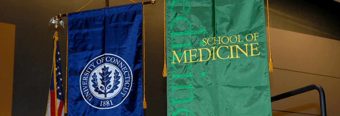 UConn and School of Medicine banners hanging at commencement