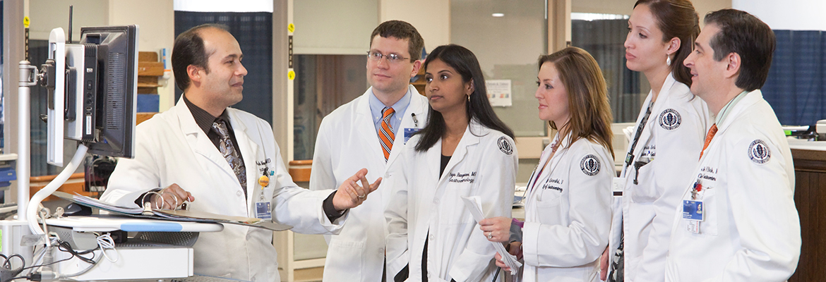 Dr. John Birk with fellows doing rounds