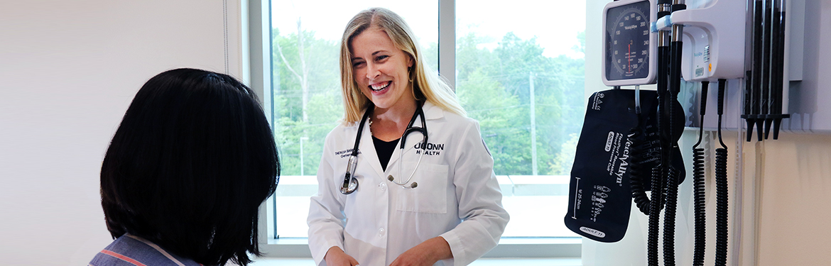 Britta L. Shute, FNP-BC, talking to a patient