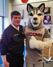 Jim Brown with the UConn Husky Dog