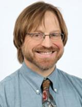 Charles Whitaker, M.D.