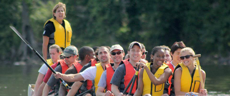 Emergency Medicine residents canoeing down a river