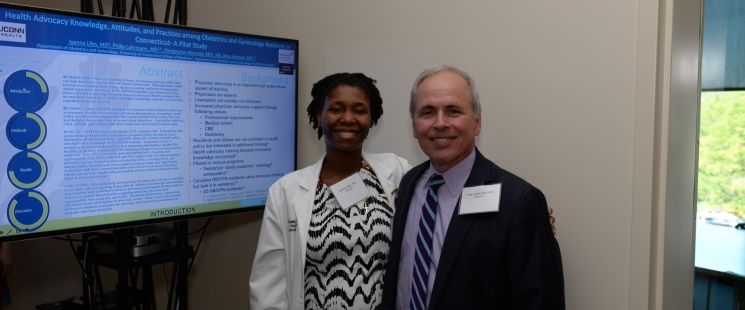 Dr. Iyanna Liles and Dr. Philip Lahrmann present their poster at the 5th Annual Connecticut Resident Research Day