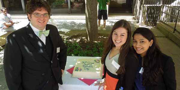 GSO Officers with celebration cake at 30th Annual Graduate Student Research Day, graduate student organization