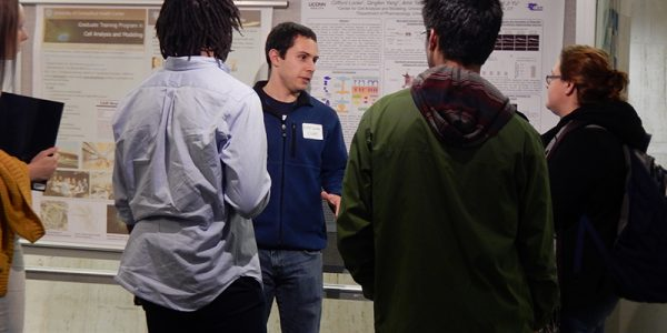 MD/PhD student presenting a poster at annual Fall Open House, graduate student organization