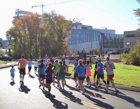 Participants running the annual SouthPark Road Race