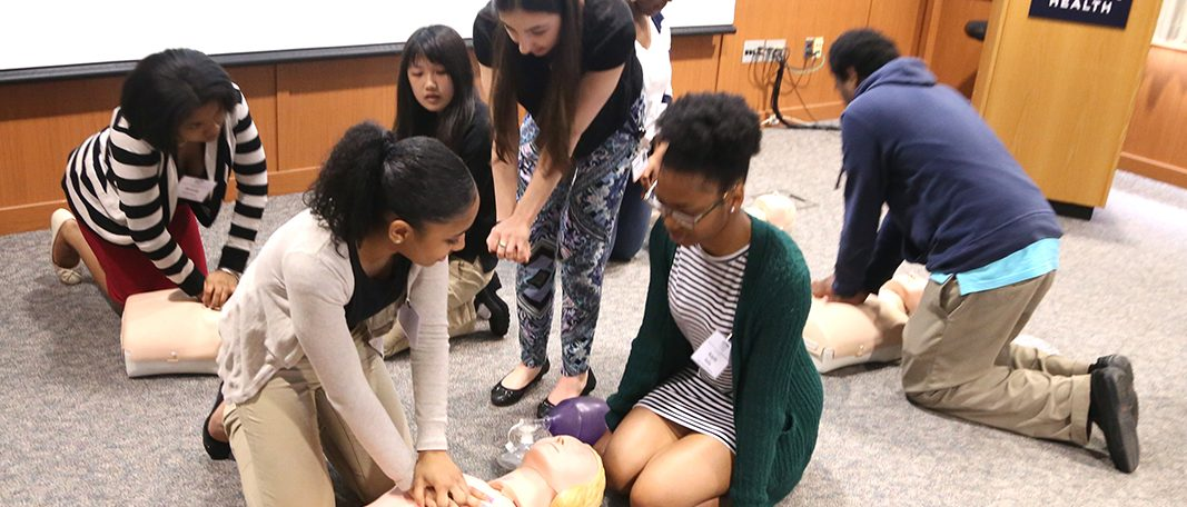 Bridge to the Future students learning CPR