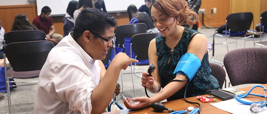 Bridge to Future students learning how to take blood pressure reading