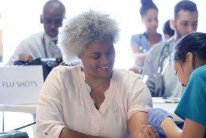 Senior woman getting her flu shot