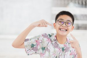 Smiling teen with braces