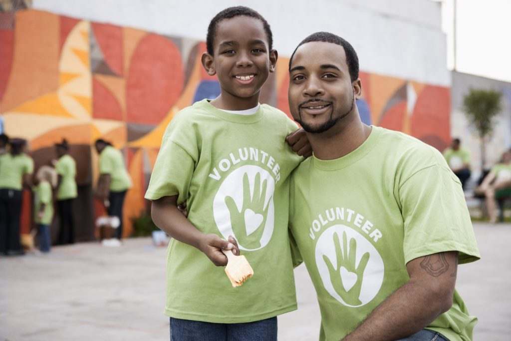 Father and son volunteering