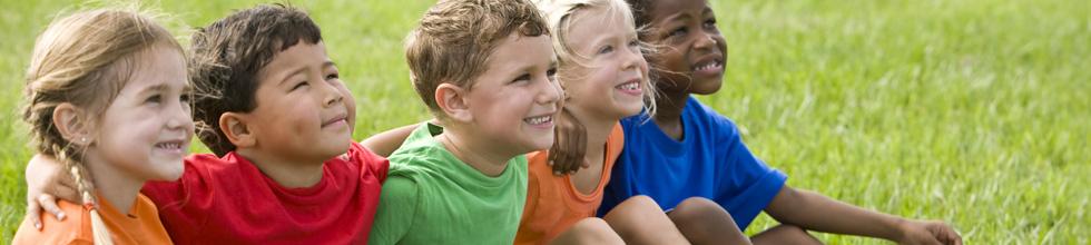 Children sitting together outside