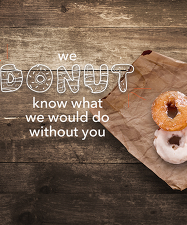 We donut what we'd do without you with donuts on a wooden table eCard