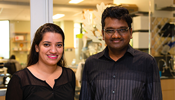 Ishita Banerjee and Vijay Rathinam, Ph.D., D.V.M., in the lab
