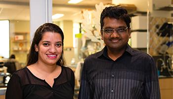 Ishita Banerjee and Vijay Rathinam, Ph.D., D.V.M., in the lab