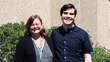 Laura Haynes, Ph.D., standing outside with Blake Torrance