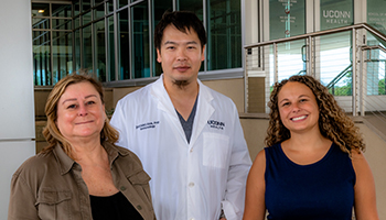 Dr. Laura Haynes standing with Drs. Zhichao Fan and Jenna Bartley