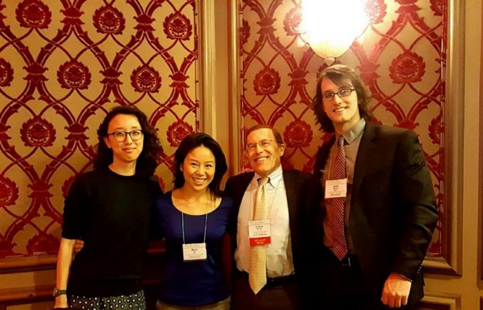 Dr. Arnold pictured with MD, Ph.D. students while attending the ASCI/ AAP annual dinner