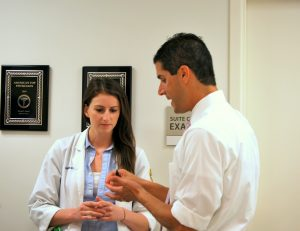 Dr. Rodner teaching a student