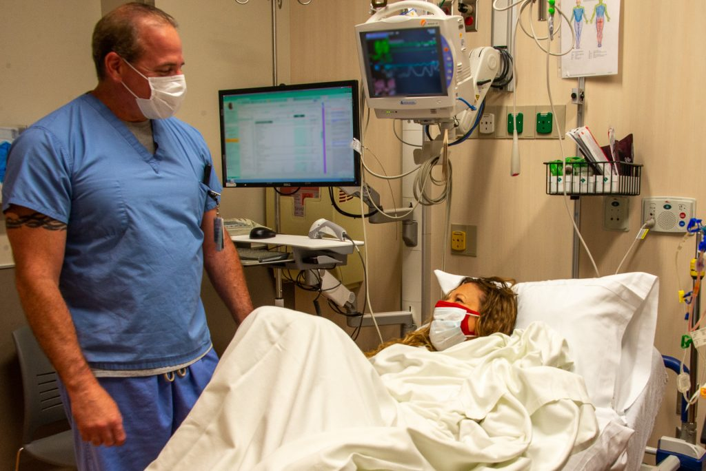Michael Morelli, RN, with patient Leah Bergeron, the first patient to undergo outpatient plasmapheresis at UConn Health