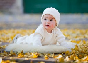 Baby with fall leaves
