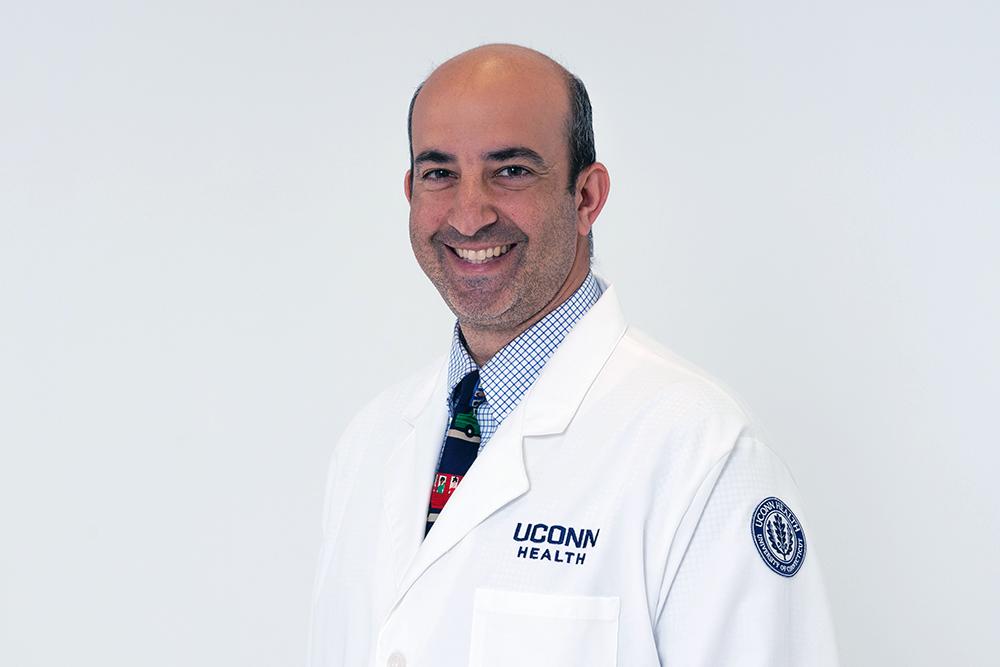 Michael Isakoff MD is a pediatric orthopedic oncologist at UConn Health on May 9, 2018. (Tina Encarnacion/UConn Health photo)