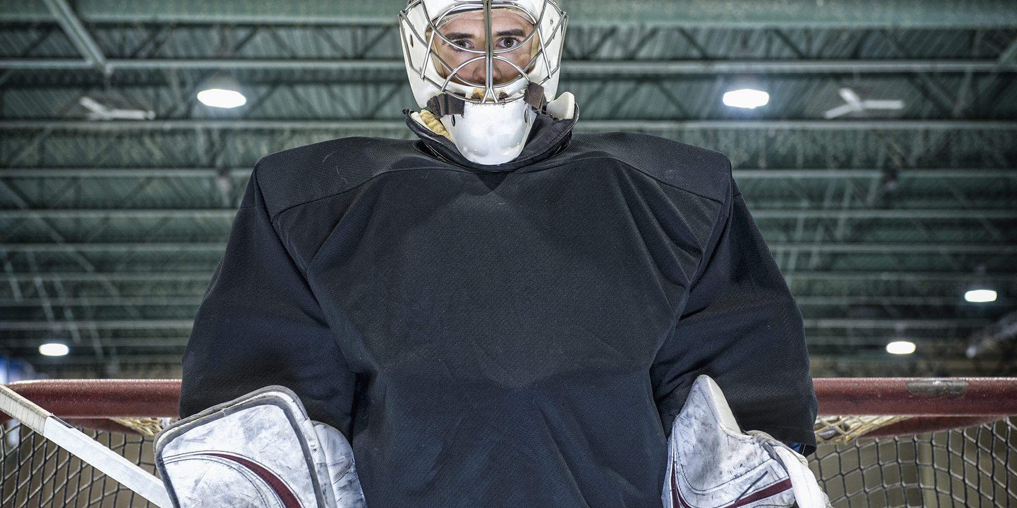 Hockey goalie standing near net