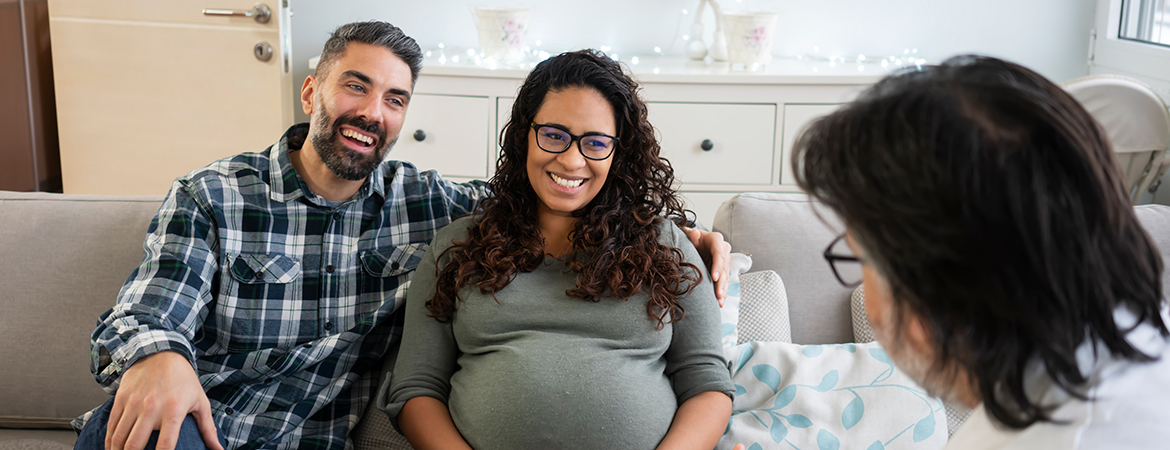 Provider visiting pregnant couple at their home
