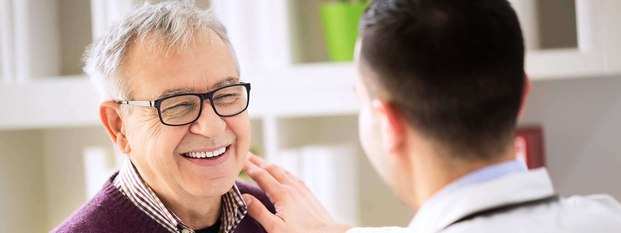 Smiling senior male patient visiting a doctor
