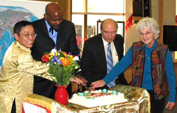 Cutting the cake at the Chinese New Year celebration are: (left to right) Ren-He Xu, Cato T. Laurencin, Marc Lalande and Carolyn Lyle
