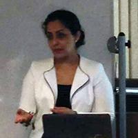 Dr. Paiyz Mikael presenting